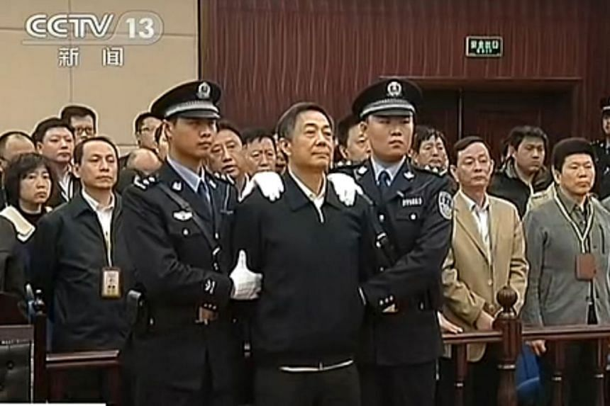 Bo Xilai in court as the decision of his appeal is announced at the Shandong Higher People's Court in Jinan, in this still image taken from video on Oct 25, 2013. The court rejected his appeal and upheld his life sentence on charges of bribery, cor