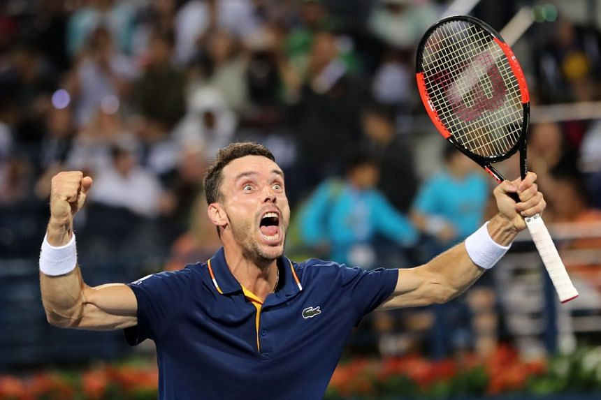 Bautista Agut reacts after defeating France's Lucas Pouille.