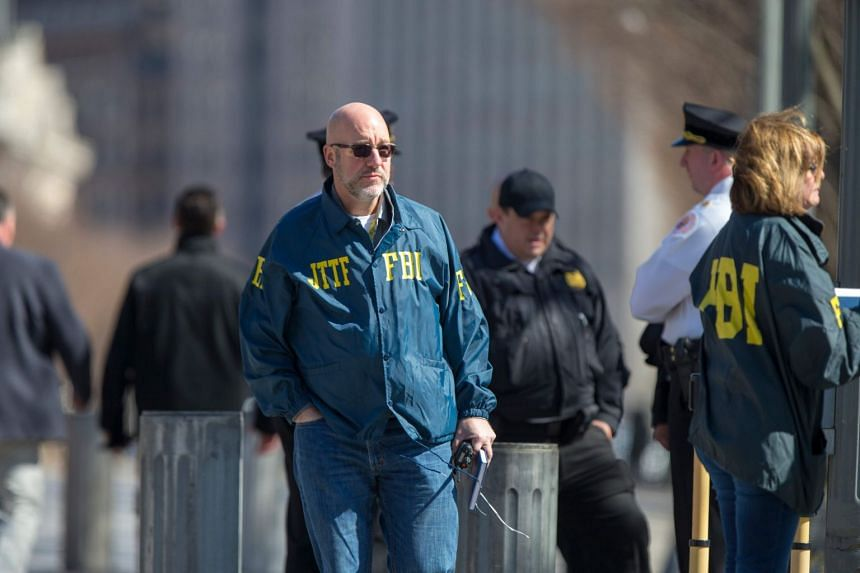 FBI officers are seen outside the White House as several blocks are closed down by the US Secret Service.