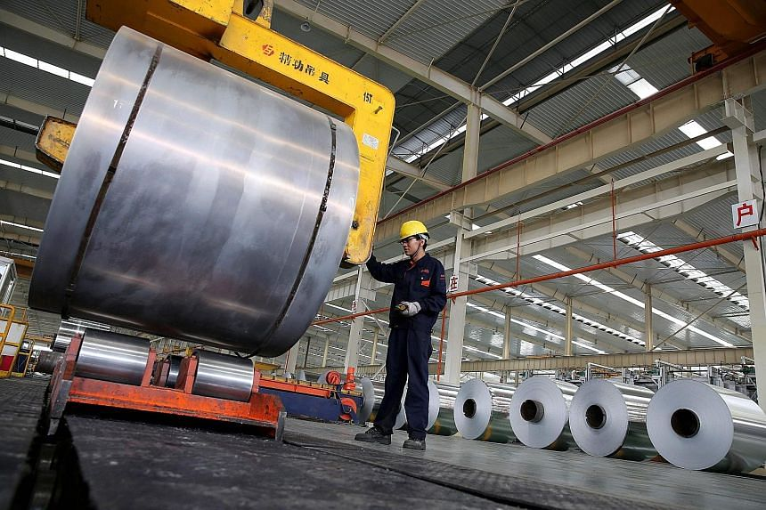 Aluminium tapes at a production plant in Anhui, China. US stocks pared their losses last Friday after a massive sell-off the day before following President Donald Trump's vow to impose severe tariffs on steel and aluminium. The anxiety over a trade w