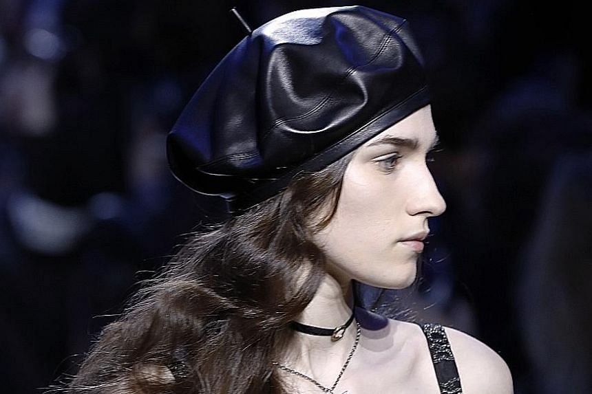 Berets were seen on the Dior fashion show (far left) and on singer Rihanna (left), both in Paris in March last year.