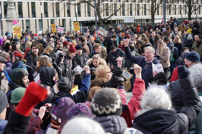 Academic staff and students at Bristo Square in the University of Edinburgh at a solidarity rally last Monday in support of the strikes by staff over changes to their pension scheme.