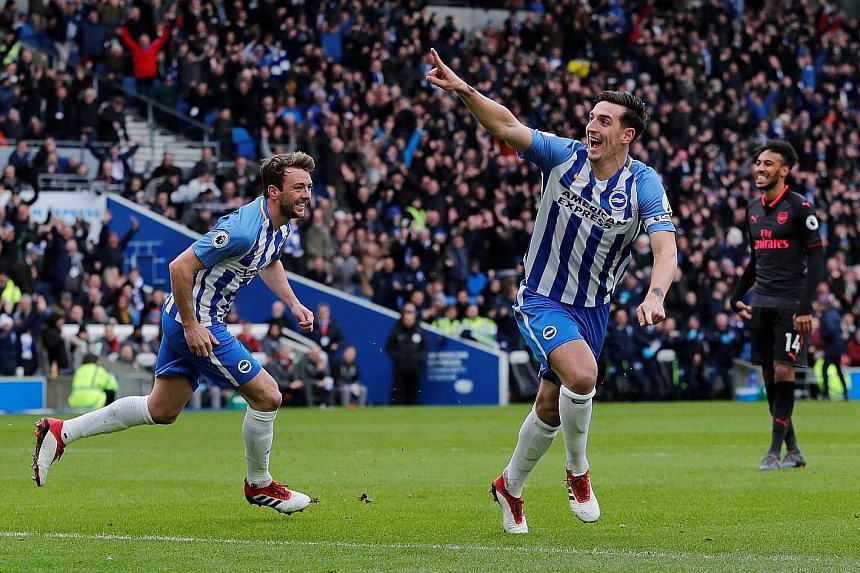 Brighton's Lewis Dunk celebrating scoring their first goal against Arsenal, having rifled home after he was first to react to a knockdown from a corner. The promoted side won 2-1.