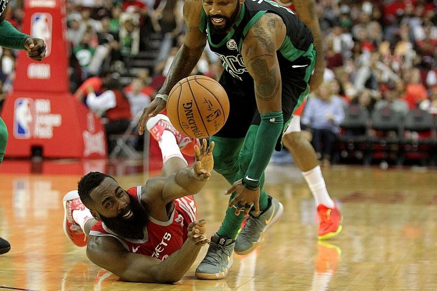 Houston Rockets guard James Harden fighting tooth and nail for the loose ball against the Boston Celtics during their 123-120 home victory on Saturday.