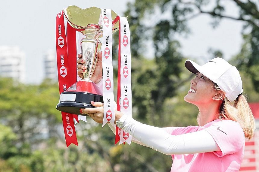 American Michelle Wie, holding aloft the HSBC Women's World Championship trophy, has battled multiple injuries in recent years before she returned to winning ways yesterday.