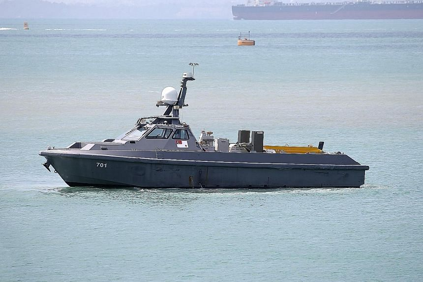Above: The unmanned surface vessel, now on trial, can be controlled remotely by two operators. Right: Fitted with a towed synthetic aperture sonar system, the USV can be configured for coastal patrols in future.