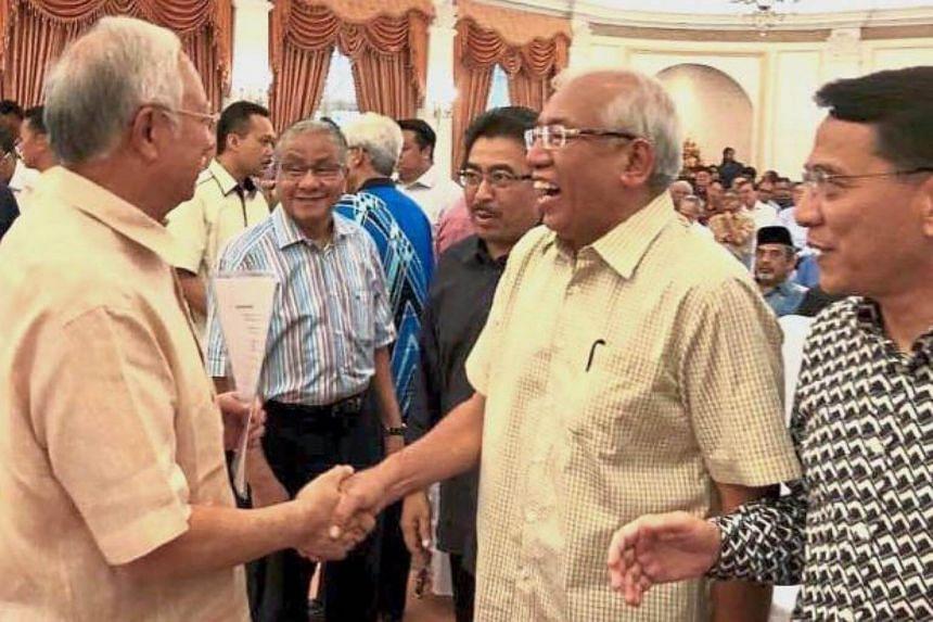 Malaysia's Prime Minister Najib Razak (left) shaking hands with Education Minister Seri Mahdzir Khalid at a Barisan pre-council meeting in Seri Perdana, Putrajaya.