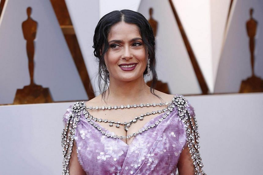 Actress Salma Hayek, one of more than 70 women who accused film producer Harvey Weinstein of sexual impropriety, on the red carpert of the 90th Academy Awards.