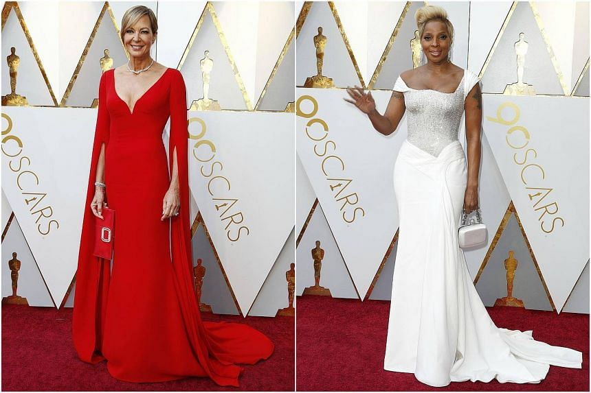 Celebrities Allison Janney (left) and Mary J. Blige posing for photos at the red carpet of the 90th Academy Awards.