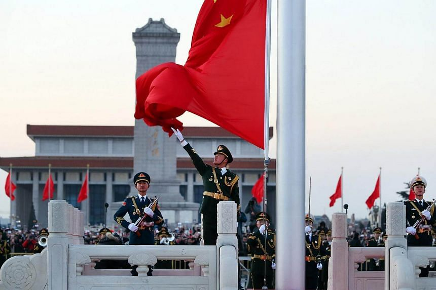 A flag-raising ceremony taking place outside Tiananmen Square in Beijing on Jan 1, 2018.
