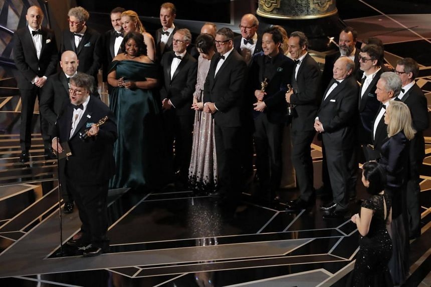 Director Guillermo del Toro on stage with the cast and crew to accept the Oscar for Best Picture for The Shape Of Water.