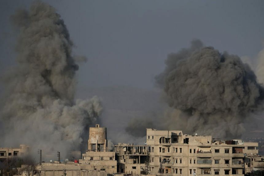 Smoke billows following Syrian government bombardments on the besieged rebel-held town of Hamouria in the eastern Ghouta region on the outskirts of the capital Damascus on March 3, 2018.