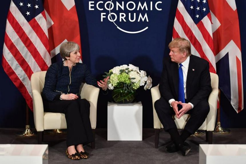 US President Donald Trump and Britain's Prime Minister Theresa May speak during a bilateral meeting on the sidelines of the World Economic Forum annual meeting in Davos, eastern Switzerland, on Jan 25, 2018.