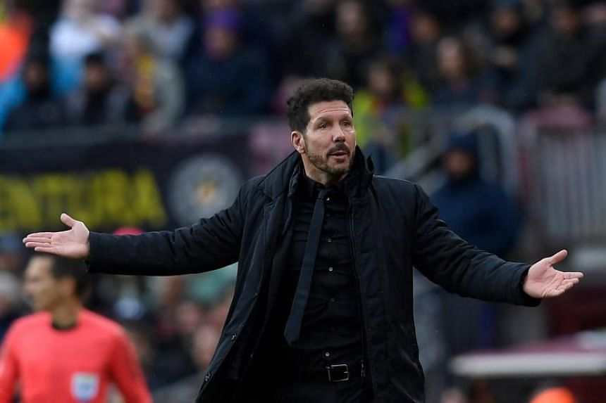 Atletico Madrid's Argentinian coach Diego Simeone gestures during the Spanish league football match FC Barcelona against Club Atletico de Madrid at the Camp Nou stadium in Barcelona on March 4, 2018.