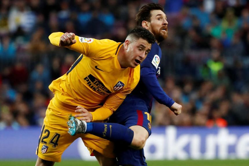 Barcelona's Lionel Messi in action with Atletico Madrid's Jose Gimenez at Camp Nou, Barcelona, Spain on March 4, 2018.