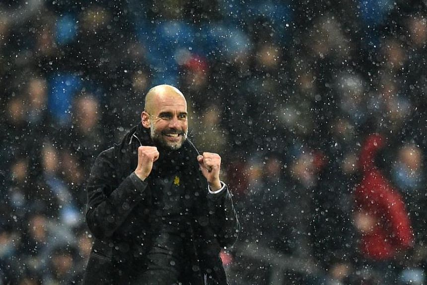 Manchester City's Spanish manager Pep Guardiola reacts after the English Premier League football match between Manchester City and Chelsea at the Etihad Stadium in Manchester, north west England on March 4, 2018.