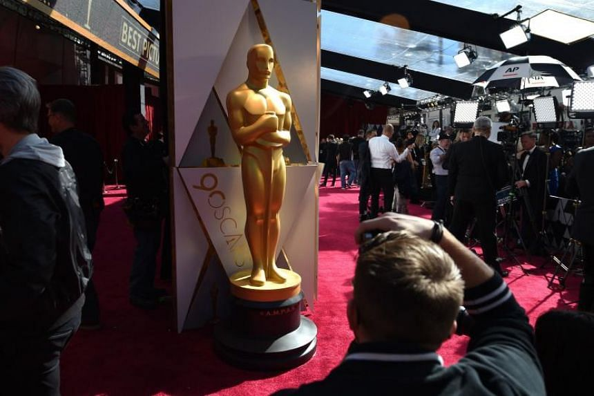 Photographers and TV crews get ready on the red carpet a few hours before the Oscars, the 90th Annual Academy Awards on March 4, 2018, in Hollywood, California.