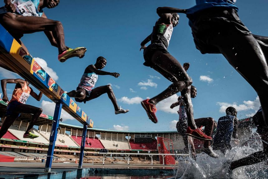 Athletes compete in the final of the men's 3,000m steeplechase during the trials for the 2018 Commonwealth Games at Kasarani Stadium in Nairobi on Feb 17, 2018.