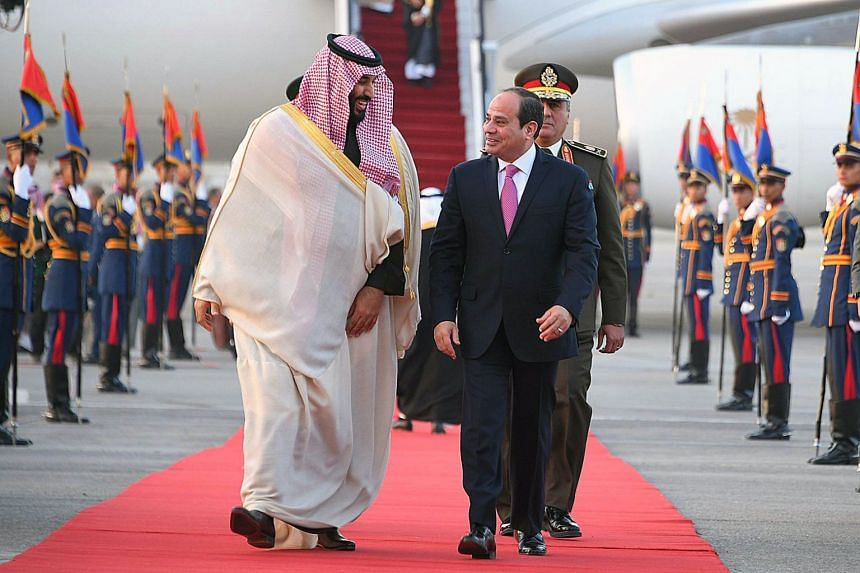 Egyptian President Abdel Fattah al-Sisi welcomes Saudi Arabia's Crown Prince Mohammed bin Salman upon his arrival in Cairo on March 4, 2018.