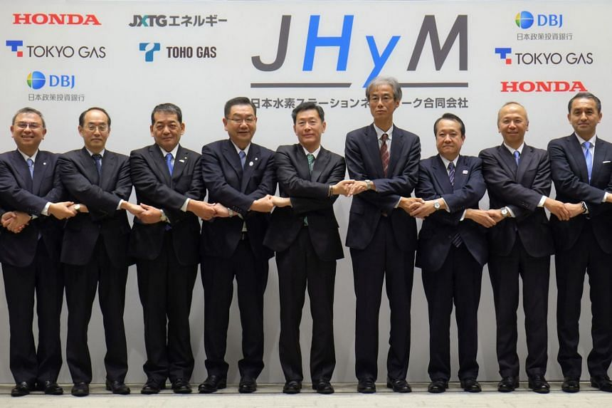 Japan H2 Mobility President Hideki Sugawara (fifth from left) and representatives of its joint establishment companies pose for a group photo after their joint press conference in Tokyo on March 5, 2018.