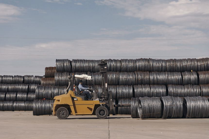 Bales of raw steel imports sit at the Insteel Industries factory in Houston on March 2, 2018. With the prospect of higher steel prices, the company fears losing business to foreign competitors paying less for raw materials.