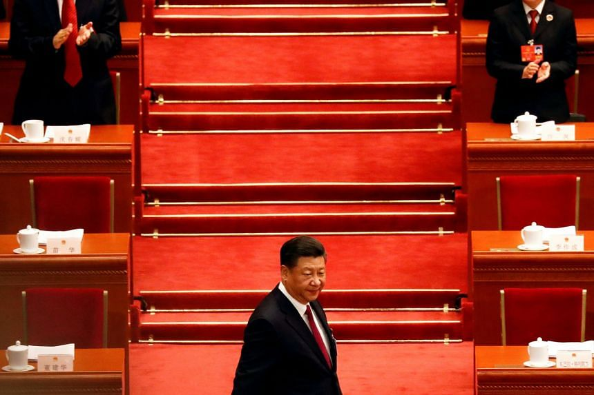 Chinese President Xi Jinping arrives for the opening session of the National People's Congress at the Great Hall of the People in Beijing on March 5, 2018.