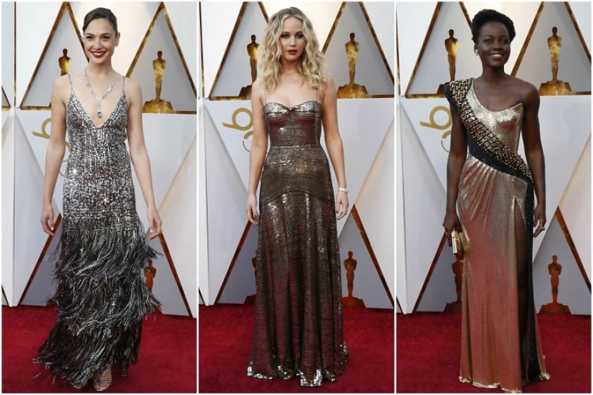 (From left) Gal Gadot, Jennifer Lawrence and Lupita Nyong'o on the red carpet at the 90th Annual Academy Awards at the Dolby Theatre in Hollywood, California.
