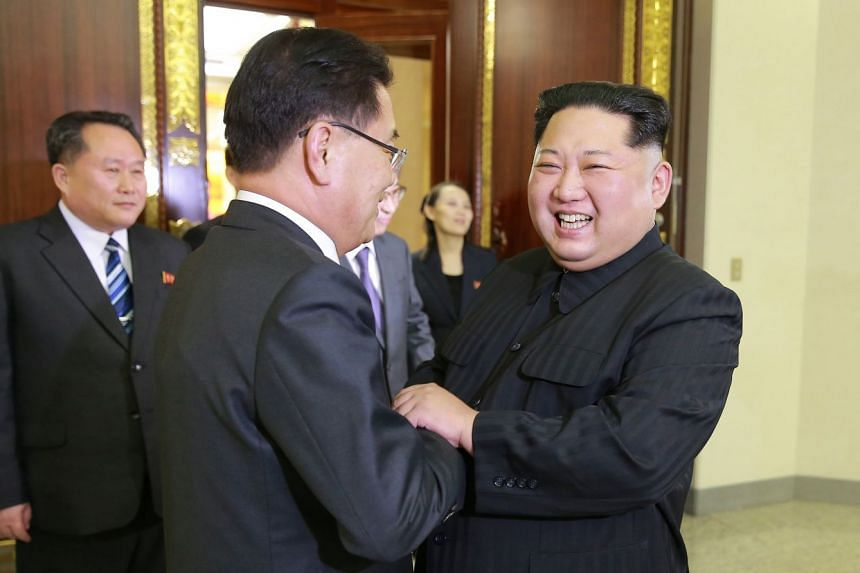 North Korean leader Kim Jong-un (right) welcoming South Korean delegates during a meeting in Pyongyang on March 5, 2018.