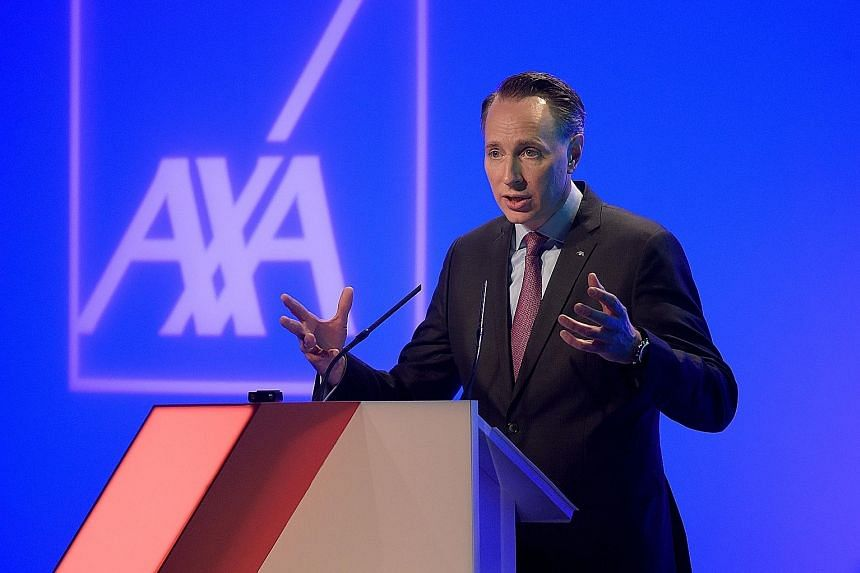 AXA chief executive Thomas Buberl said the purchase of XL Group will enable AXA to dominate the global property and casualty insurance market, and reduce its exposure to the volatility of financial markets.