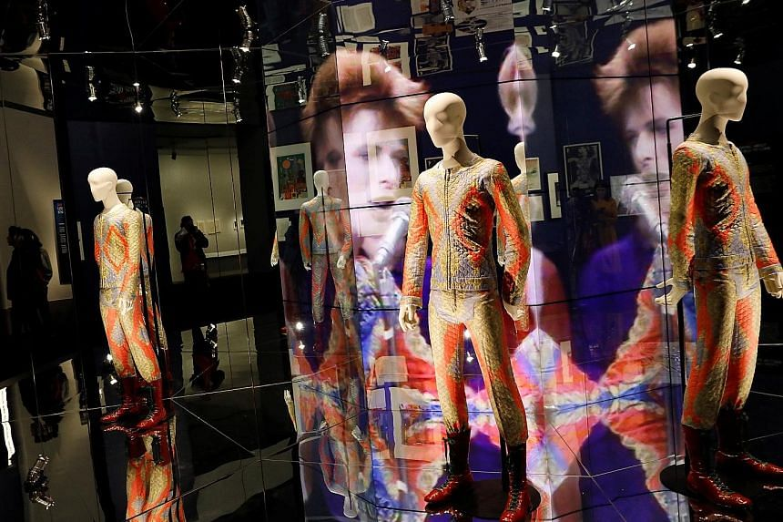 Transmuting visual cool into magnetic listening pleasure was David Bowie's hallmark for the length of his protean, nearly 55-year career. And it is on electrifying display at the Brooklyn Museum in David Bowie Is, a far-reaching survey of his artistr
