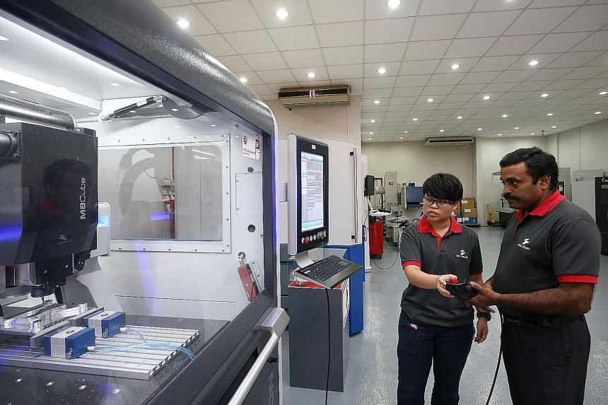 Ichi Seiki application engineer Chui Kher Ning has trained fellow application engineer Krishnan Thiagarajan to use the company's new precision engineering machines, after she was trained by German specialists last year.