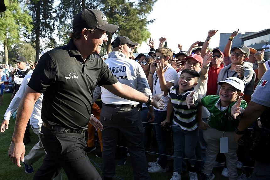 WGC-Mexico Championship winner Phil Mickelson being greeted by fans after his play-off success over world No. 2 Justin Thomas on Sunday. The 47-year-old American had not won since the 2013 British Open, a run of 101 events.