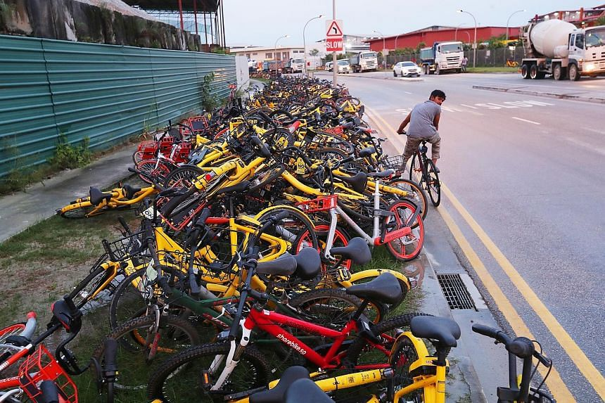 Rental bicycles parked indiscriminately (clockwise from top left) near Yishun MRT station, at Marina Barrage and in Seletar North Link. Under the proposed scheme, operators must remove such bicycles in a timely manner or face sanctions.
