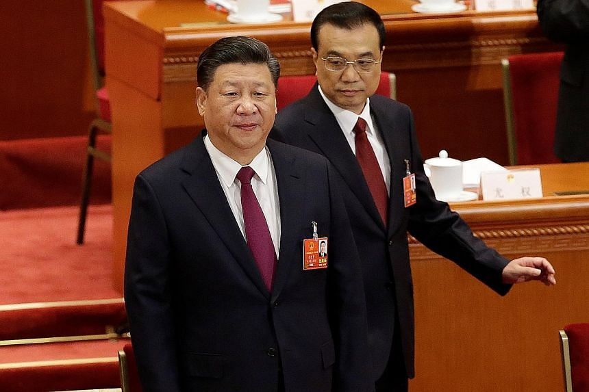 President Xi Jinping and Premier Li Keqiang at the NPC session. Mr Li delivered a work report listing key tasks such as restructuring the economy. Stewardesses at Tiananmen Square before the opening of the first session of the 13th National People's