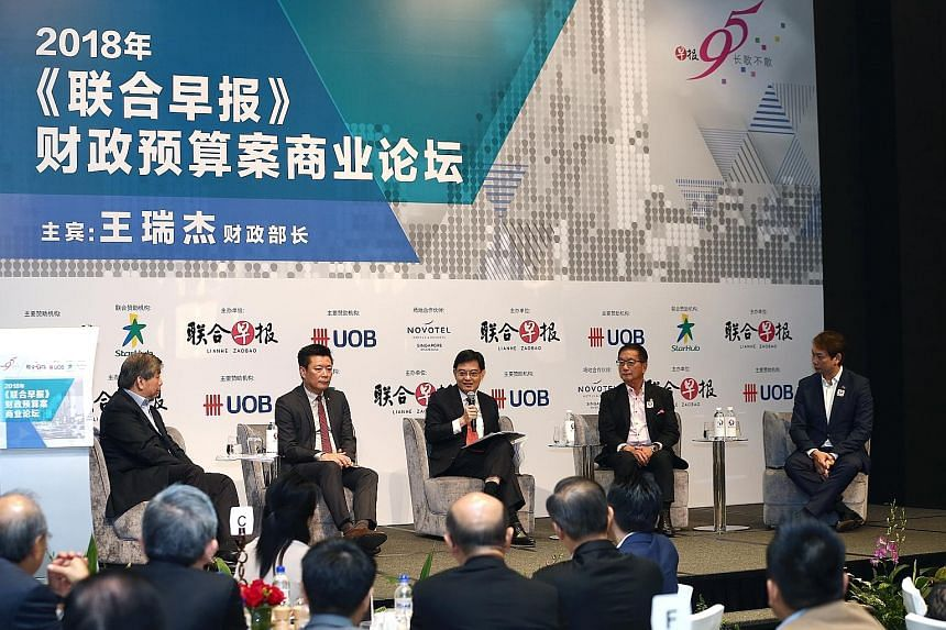 With Finance Minister Heng Swee Keat at the post-Budget forum organised by Chinese daily Lianhe Zaobao yesterday were (from left) Singapore Business Federation chairman Teo Siong Seng, Lianhe Zaobao and Lianhe Wanbao editor Goh Sin Teck, Singapore Ch