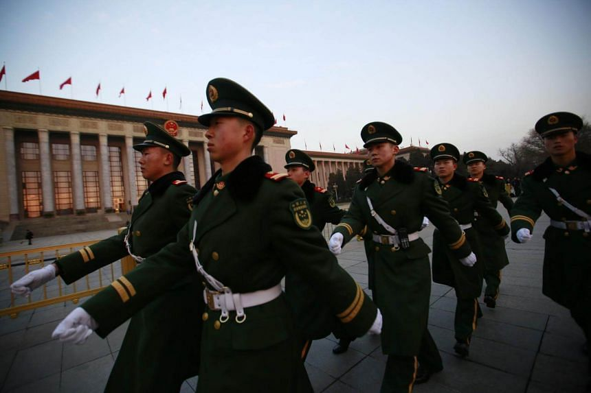 People's Liberation Army soldiers outside the Great Hall of the People prior to the opening of the first session of the 13th National People's Congress on Mar 5, 2018, in Beijing, China.