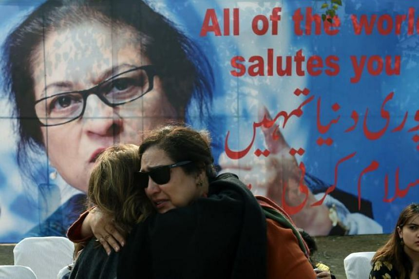Pakistani colleagues of lawyer and rights advocate Asma Jahangir mourn during her funeral in Lahore on Feb 13, 2018.