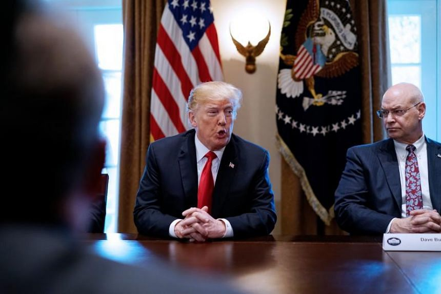 US President Donald Trump speaks on steel and aluminum tariffs, watched by Dave Burkitt (right) of US Steel Corporation, during a meeting with industry leaders in the Cabinet Room of the White House on March 1, 2018 in Washington, DC.