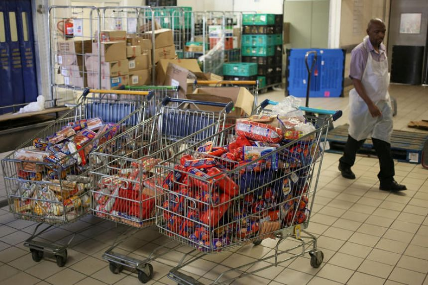 """A worker walks past cold meat products know as """"polony"""" after they were removed from the shelves of Pick n Pay Store in Johannesburg, South Africa, on March 5, 2018."""