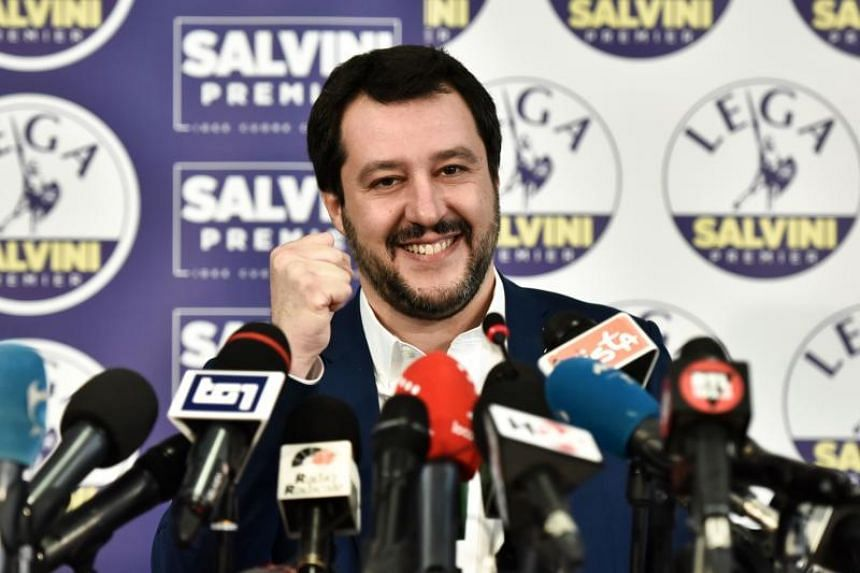 Lega far right party leader Matteo Salvini smiles and rises his fist at the Lega headquarter in Milan on March 5, 2018 for a press conference ahead of the Italy's general election results.