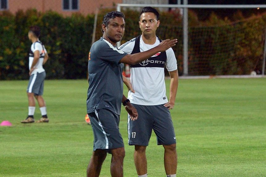 Singapore coach V. Sundram Moorthy and Shahril Ishak at a training session in May 2016. Sundram declined to comment about his decision to drop the trio.