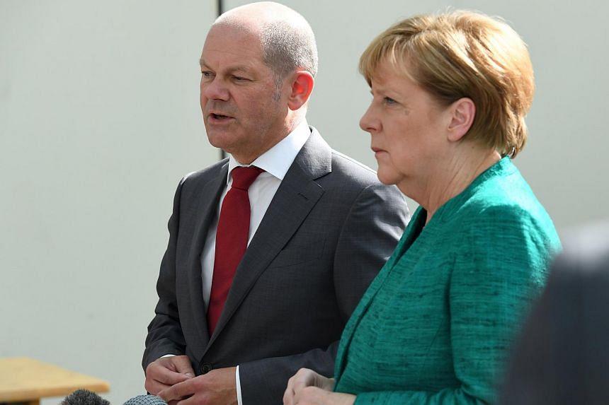 A file photo of German Chancellor Angela Merkel and Mayor of Hamburg Olaf Scholz at the G20 Summit in Hamburg, Germany, on July 8, 2017.