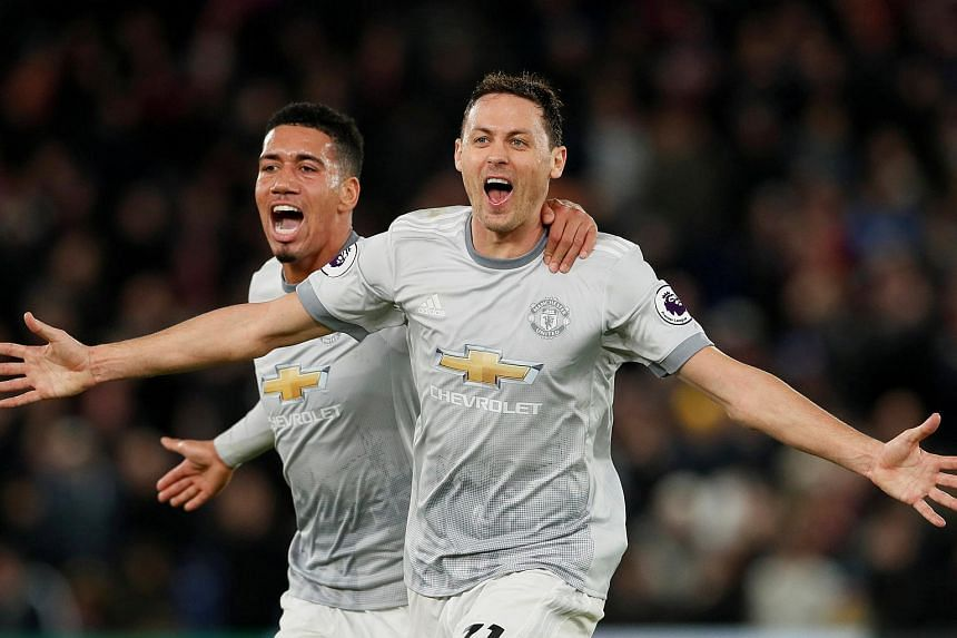 Manchester United's Nemanja Matic celebrates scoring their third goal with Chris Smalling at Selhurst Park, London, Britain on March 5, 2018.