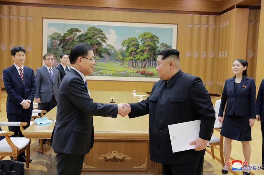 North Korean leader Kim Jong Un shakes hands with a member of the special delegation of South Korea's President in this photo released by North Korea's KCNA, on March 6, 2018.