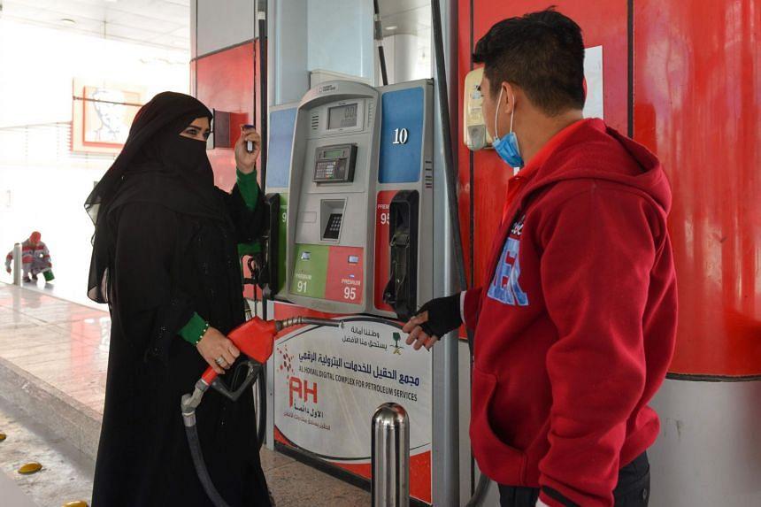 Saudi gas station supervisor Mervat Bukhari (left) standing near a worker at her workplace in Khobar, 400km east of Riyadh, on Feb 20, 2018.
