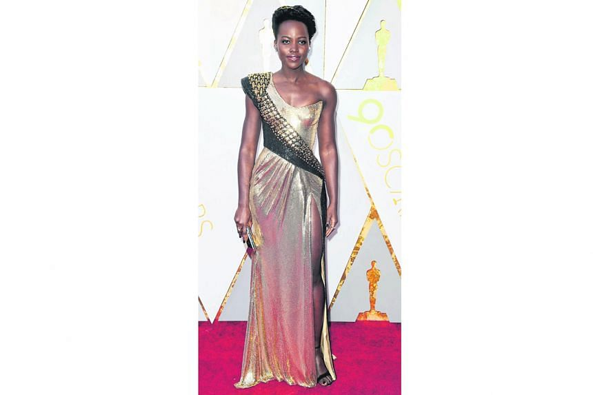 Lupita Nyong'o rarely gets it wrong on the red carpet and this year is no exception. Her form-fitting custom atelier Versace gown looks like liquid armour and gives viewers serious throwbacks to her tough warrior princess role in Black Panther.