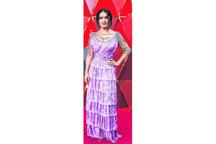 More is not always better - as is the case of actress Salma Hayek's Gucci number, which has way too much going on with its overly kitschy lavender colour, all-over sequins, tiers and crystal body chains.