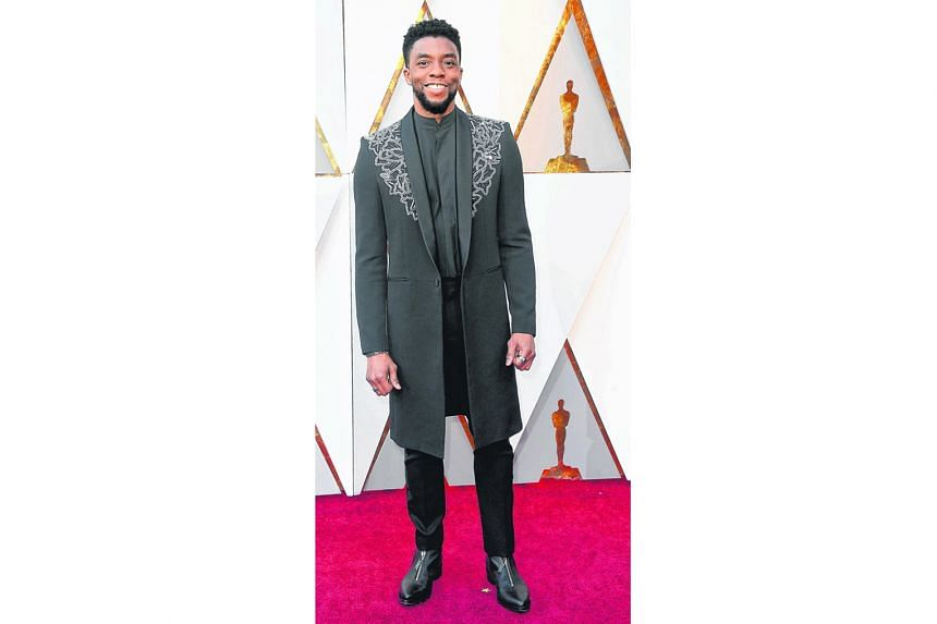 Black Panther star Chadwick Boseman scores serious style points for leaving his tuxedo at home and turning up on the red carpet in a knee-length embellished coat jacket instead. It is just bedazzled enough to be interesting, but sleek enough to fit the fo