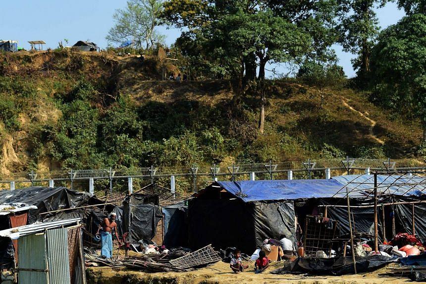 Rohingya refugees renovate their temporary homes along the Myanmar-Bangladesh border on Feb 27, 2018.