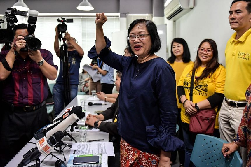 Maria Chin Abdullah (centre), former chairperson of the coalition of Malaysian NGOs and activist groups known as Bersih, gestures after a press conference in Kuala Lumpur on March 6, 2018.